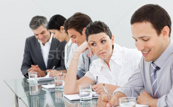 Belle femme d'affaires s'ennuie présentation équipe réunion Photo stock © wavebreak_media