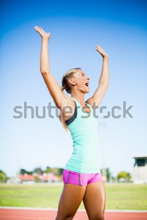 Cute woman punching the air outdoor  Stock photo © wavebreak_media