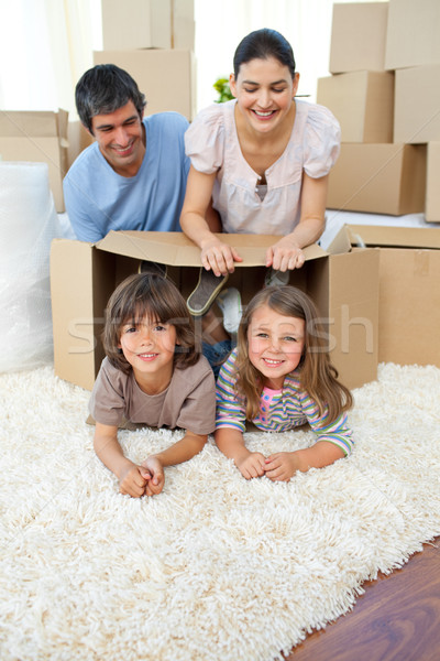 Jolly family playing with boxes Stock photo © wavebreak_media