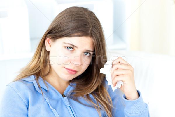 Zaklatott fiatal nő tart papírzsebkendő ül nappali Stock fotó © wavebreak_media