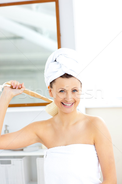 Lively woman washing her back smiling at the camera in the bathroom Stock photo © wavebreak_media