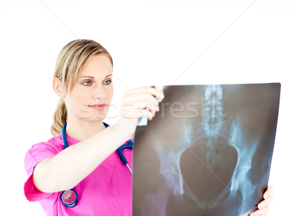 Serious female surgeon holding a x-ray against a white background Stock photo © wavebreak_media