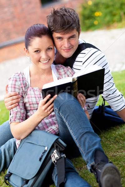 Mosolyog pár diákok olvas könyv ül Stock fotó © wavebreak_media