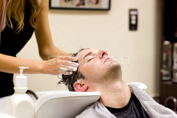 Attractive man having a shampoo in a hairdressing salon Stock photo © wavebreak_media