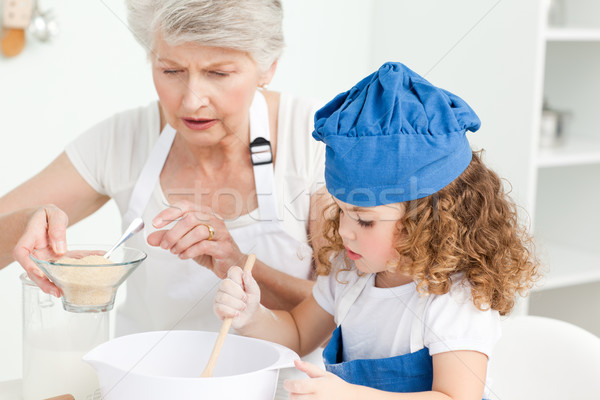 A little girl  baking with her grandmother at home Stock photo © wavebreak_media