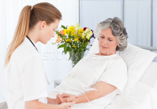 Nurse putting a drip on the arm of her patient Stock photo © wavebreak_media