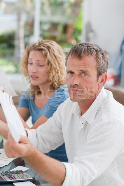 Desperate couple calculating their domestic bills at home Stock photo © wavebreak_media