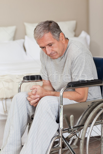 Thoughtful senior man in his wheelchair  at home Stock photo © wavebreak_media