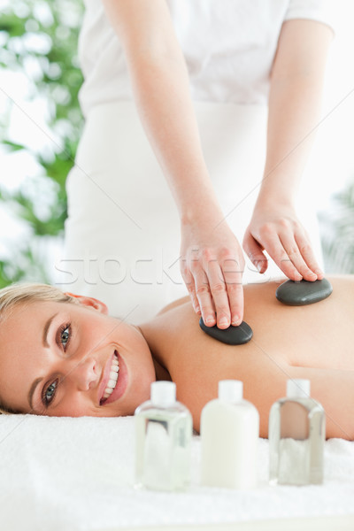 Blonde relaxed woman experiencing a stone therapy Stock photo © wavebreak_media