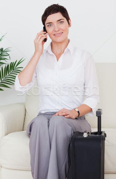 Kadın bavul telefon bekleme odası mutlu çanta Stok fotoğraf © wavebreak_media