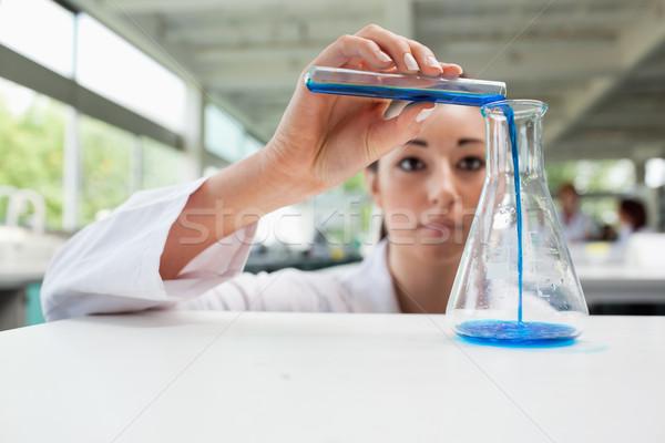 Komoly tudomány diák áramló folyadék flaska Stock fotó © wavebreak_media