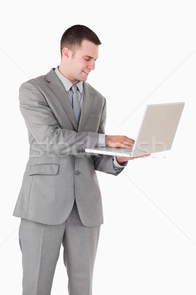 портрет молодые бизнесмен рабочих ноутбука белый Сток-фото © wavebreak_media