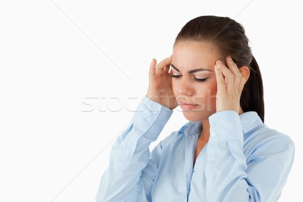 Businesswoman rubbing her temples against a white background Stock photo © wavebreak_media