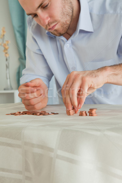 Desperate young businessman counting his small change Stock photo © wavebreak_media