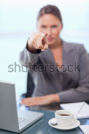 Portrait of a young businesswoman refusing a conversation in her office Stock photo © wavebreak_media