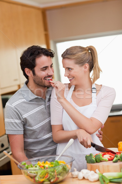 Portrait of a lovely couple cooking in their kitchen Stock photo © wavebreak_media