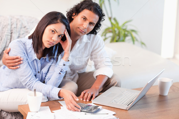 Young couple having a hard time paying their bills Stock photo © wavebreak_media