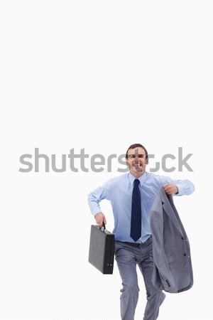 Happy businessman with suitcase about to jump against a white background Stock photo © wavebreak_media