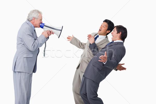 Idős eladó megafon kiabál alkalmazottak fehér Stock fotó © wavebreak_media