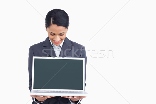 Stock photo: Close up of saleswoman showing notebook screen against a white background