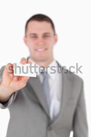 Blank business card being held by female entrepreneur against a white background Stock photo © wavebreak_media