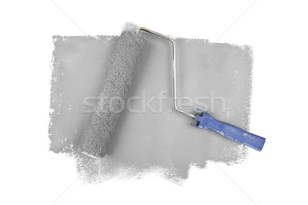 Paint roller on grey traces against a white background Stock photo © wavebreak_media