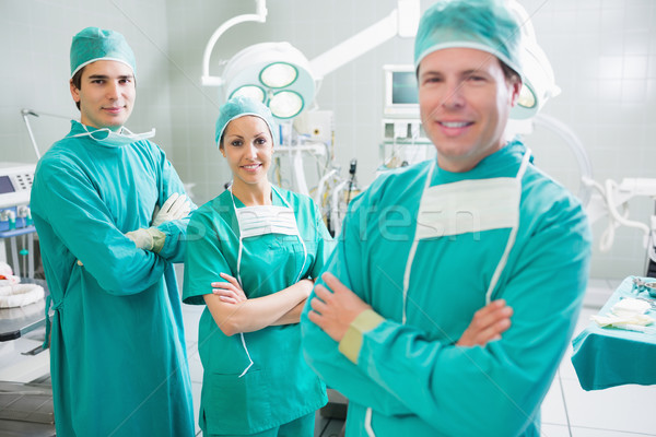 Surgical team with arms crossed smiling in an operating theatre Stock photo © wavebreak_media