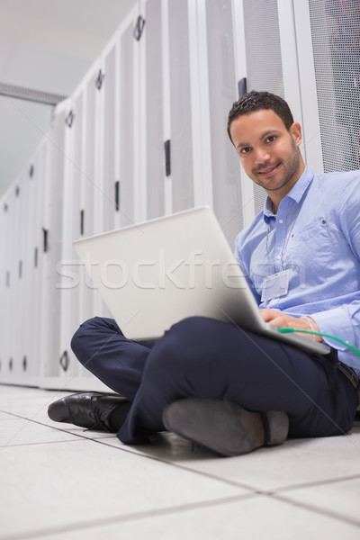 Man connecting to data store with laptop Stock photo © wavebreak_media