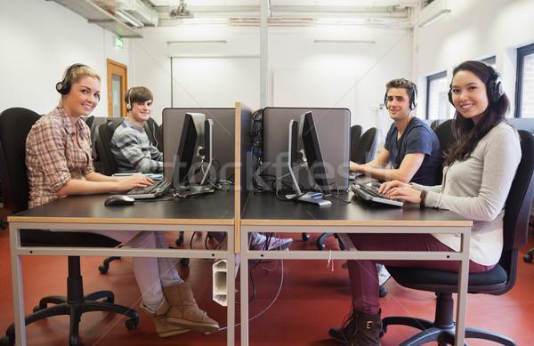 Students in computer class wearing headphones Stock photo © wavebreak_media
