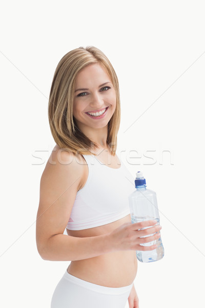 Portrait of happy young woman with water bottle Stock photo © wavebreak_media