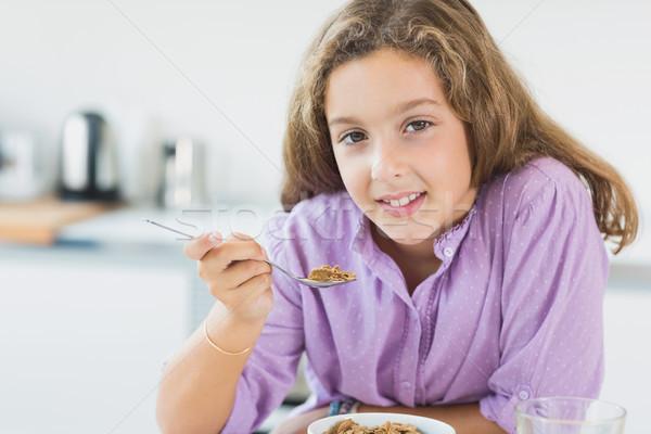 Little girl cereal café da manhã casa criança cozinha Foto stock © wavebreak_media