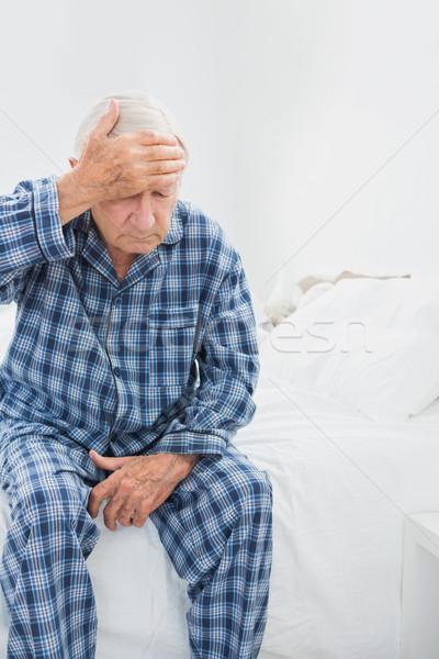 Stary cierpienie bed sypialni domu człowiek Zdjęcia stock © wavebreak_media