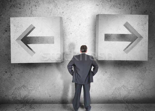 Businessman deciding which way to go Stock photo © wavebreak_media