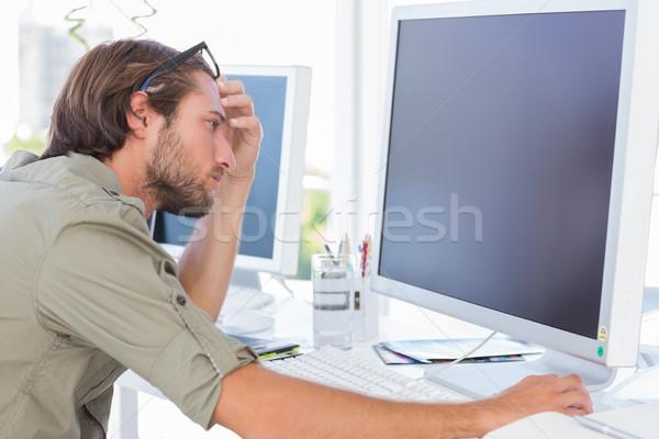 Graphic artist looking at his screen Stock photo © wavebreak_media