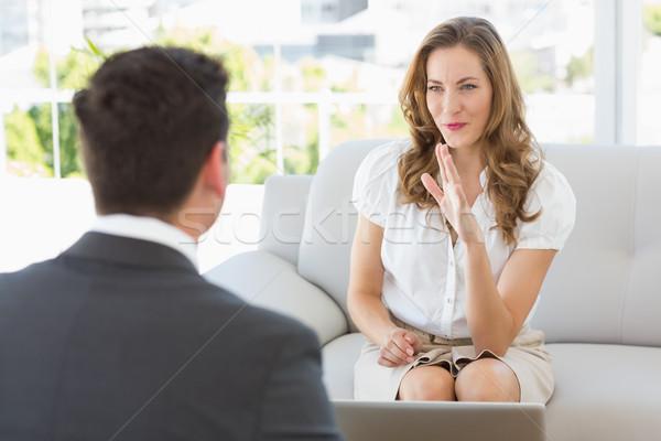 улыбающаяся женщина заседание финансовых советник улыбаясь Сток-фото © wavebreak_media