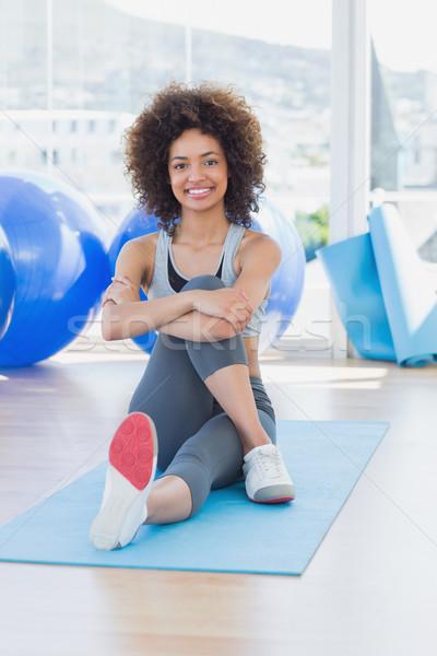 Montare donna seduta esercizio fitness studio Foto d'archivio © wavebreak_media