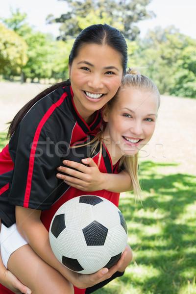 Female soccer player piggybacking teammate  Stock photo © wavebreak_media