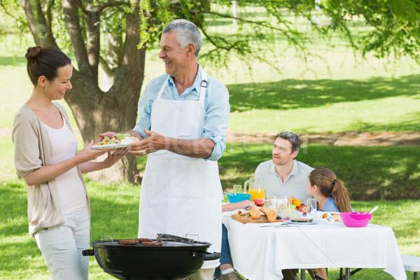 Família almoço gramado ver família grande mulher Foto stock © wavebreak_media