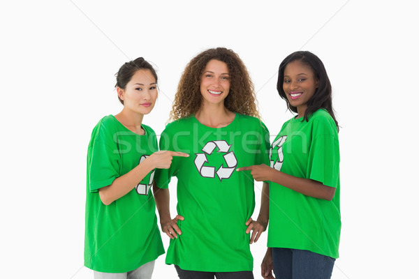 Team milieu glimlachend camera wijzend tshirt Stockfoto © wavebreak_media