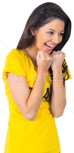 Excitado fútbol ventilador brasil camiseta blanco Foto stock © wavebreak_media