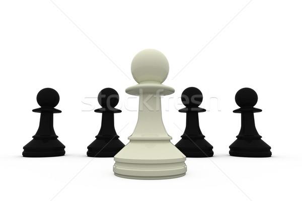 White chess pawn standing with black pieces Stock photo © wavebreak_media