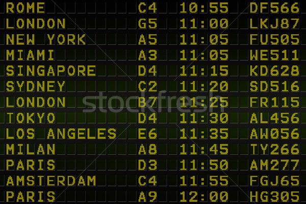 Black airport departures board with yellow text Stock photo © wavebreak_media