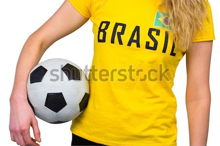 Fit girl in green bikini holding football  Stock photo © wavebreak_media