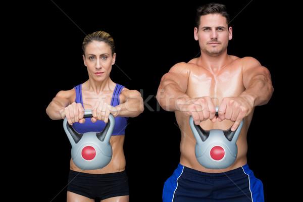 Crossfit couple posing with kettlebells Stock photo © wavebreak_media