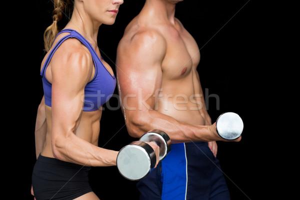 Bodybuilding paar poseren groot vrouw lichaam Stockfoto © wavebreak_media