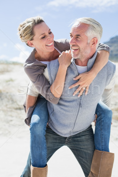 Laughing couple smiling at each other on the beach Stock photo © wavebreak_media