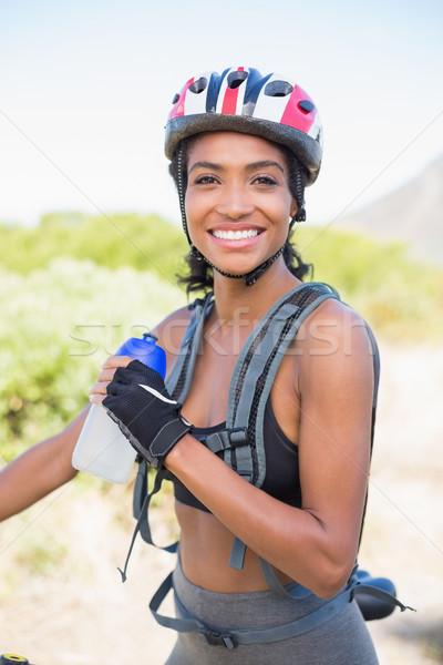 Fit woman going for bike ride holding water bottle Stock photo © wavebreak_media