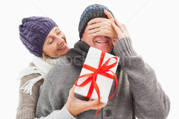 Happy mature woman hiding gift from partner Stock photo © wavebreak_media