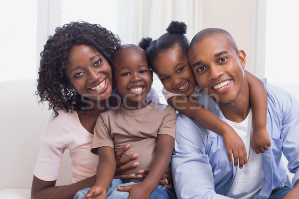 Happy family posing on the couch together Stock photo © wavebreak_media