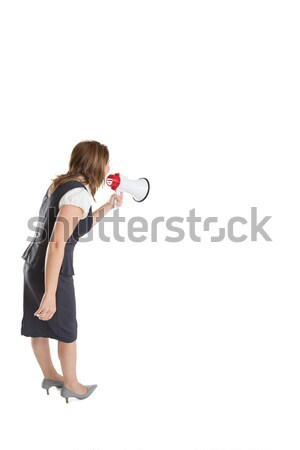 Young businesswoman shouting into bullhorn Stock photo © wavebreak_media
